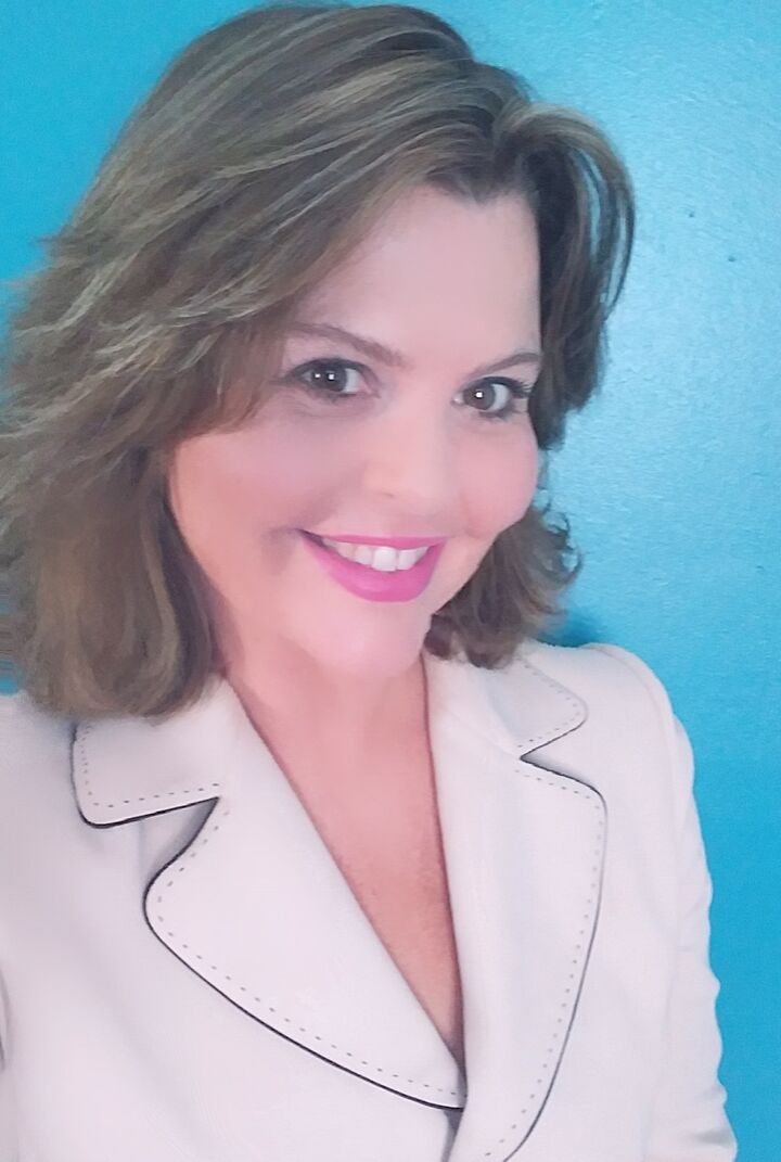 Kimberly Price,  in Brooksville, Dennis Realty & Investment Corp.